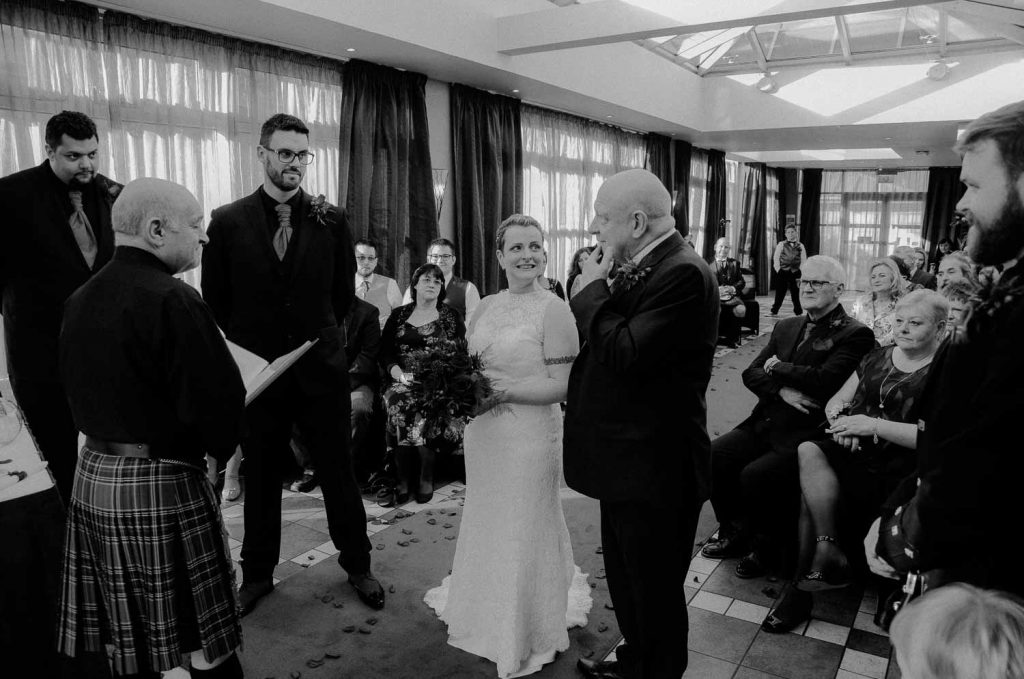 black and white father of the bride and the couple