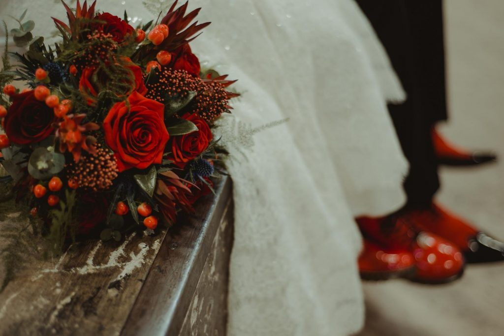 wedding bouquet and red shoes