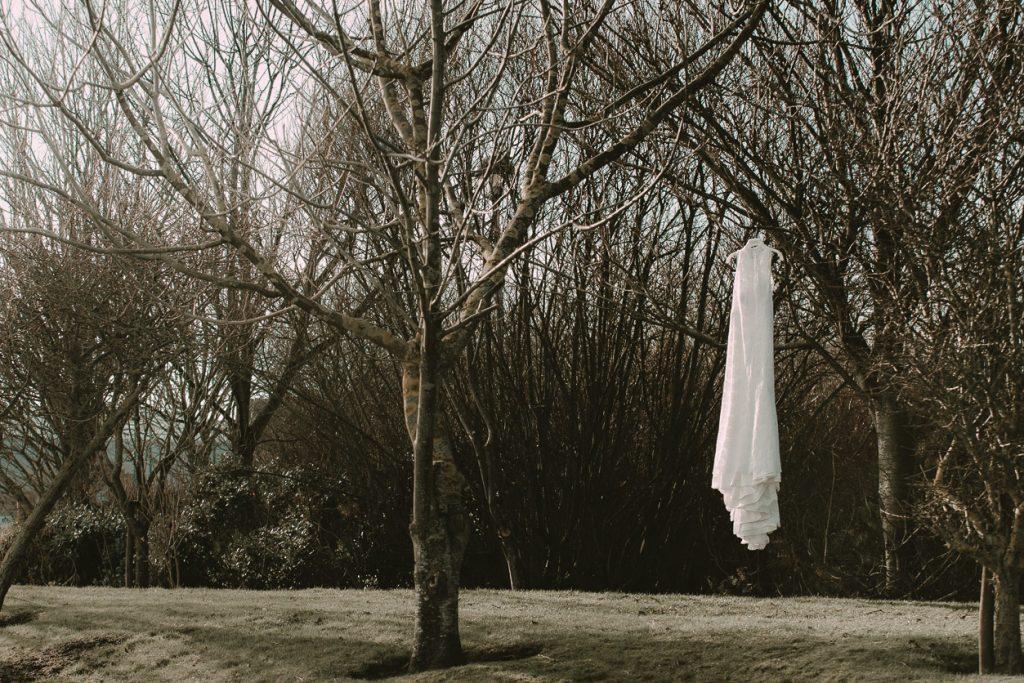 wedding dress hanging on the tree