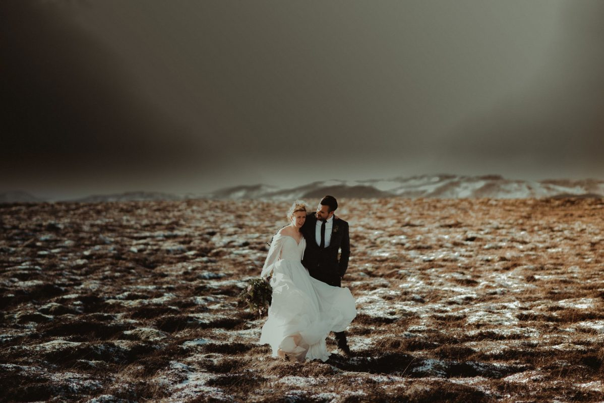 Iceland wedding portrait of a couple running in a field