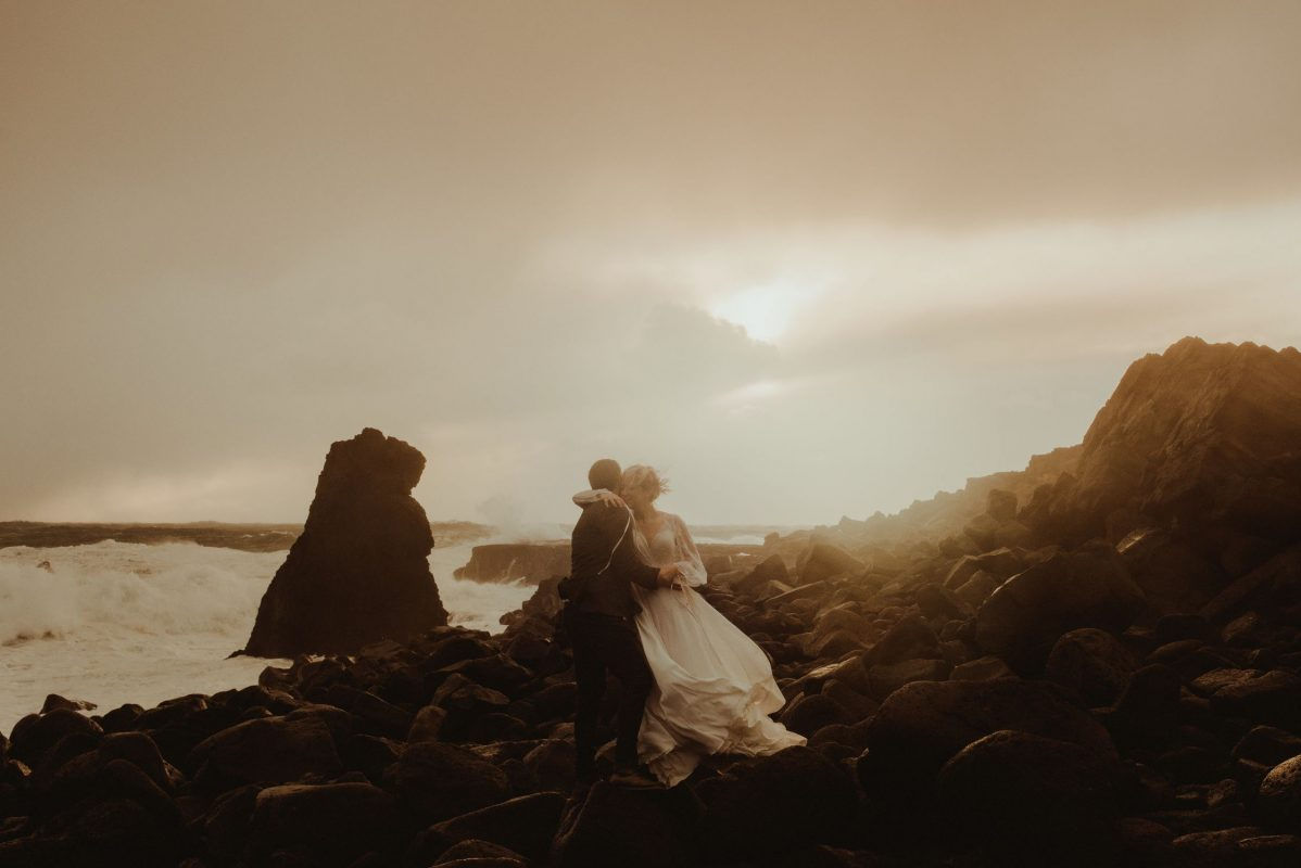 Iceland wedding portrait of a couple posing by the waves