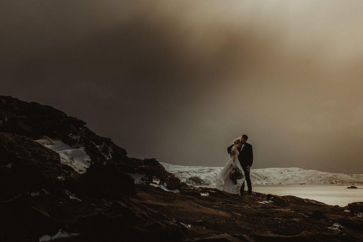 Iceland wedding couple posing by the lake