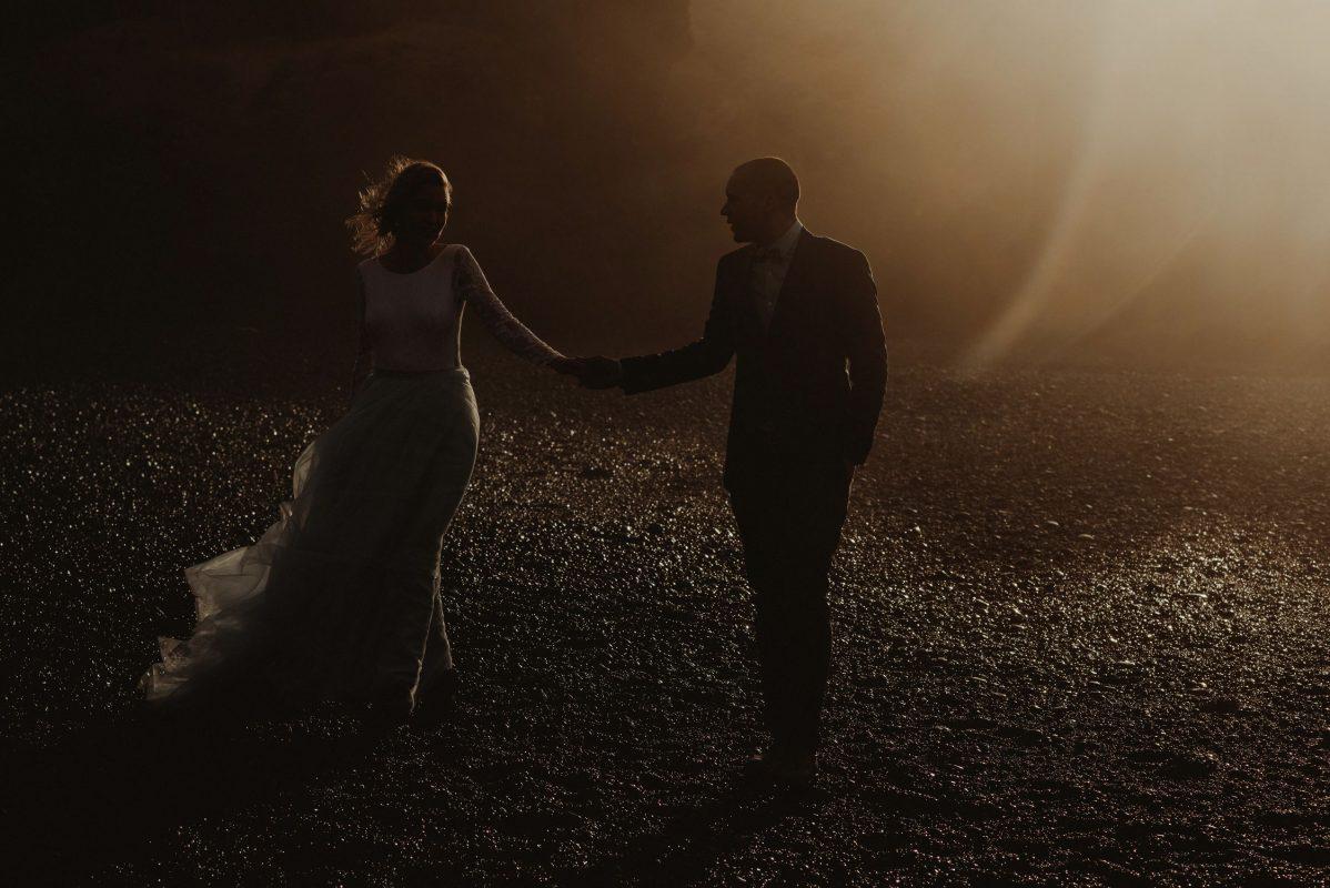 Snaefellsnes bride and groom walking in the mist