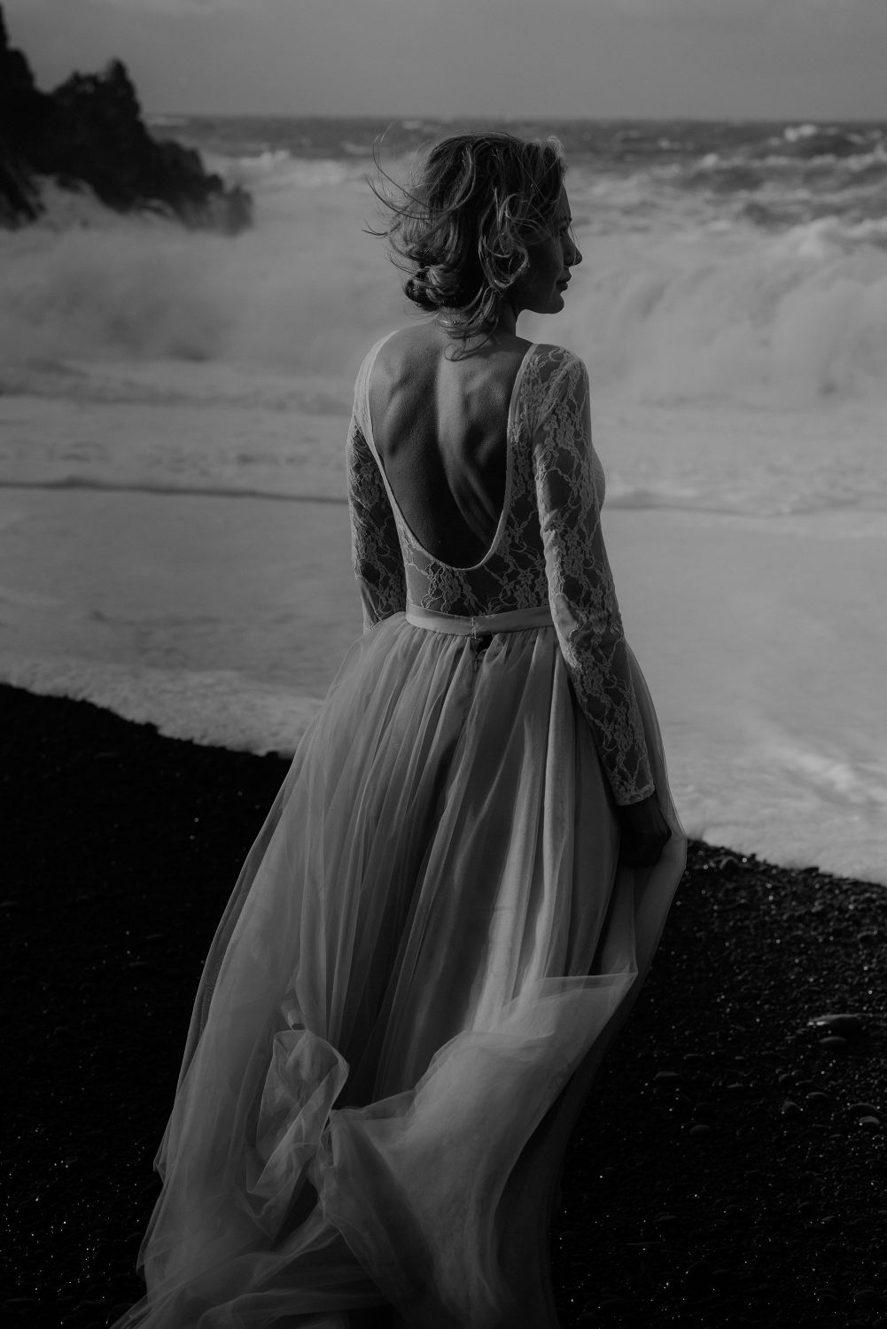 Iceland Wedding Photographer - bride looking at the sea black and white