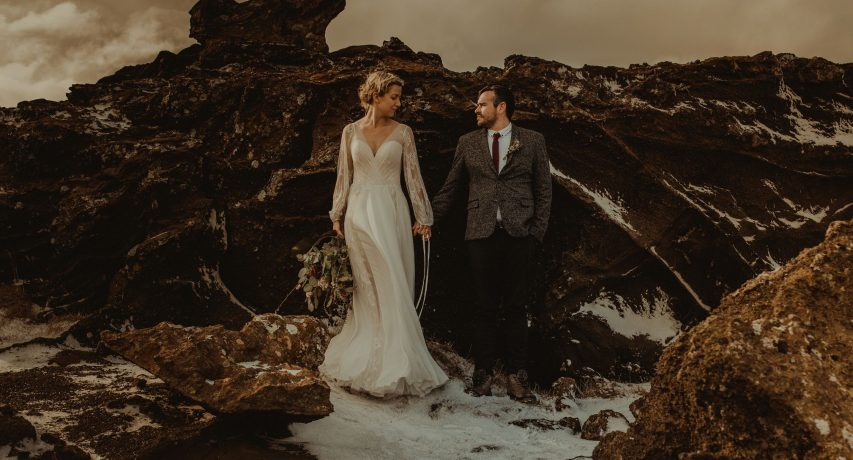 Iceland wedding portrait of a couple posing by rocks