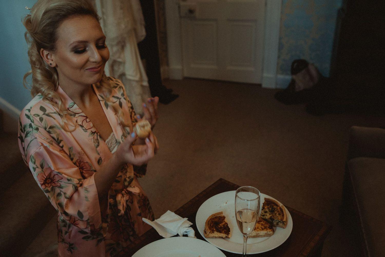 Bride eating before her wedding at Elsick House