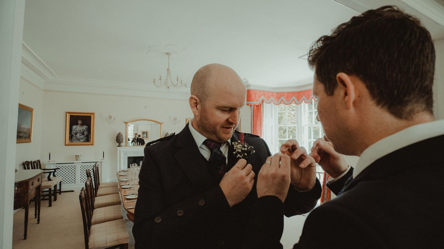 Groom getting ready for his wedding at Elsick House