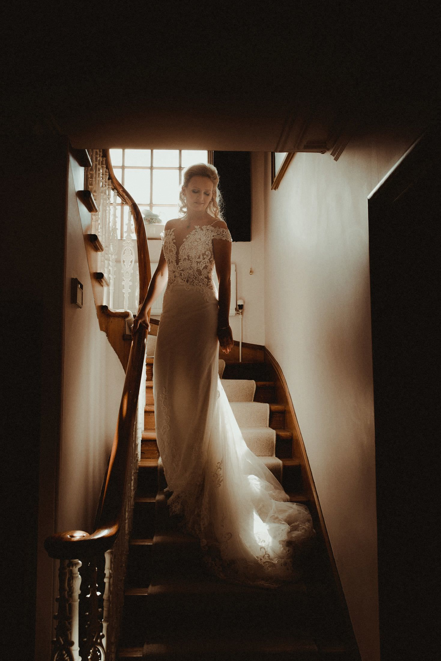 Bride walking down the stairs to go to her wedding at Elsick House