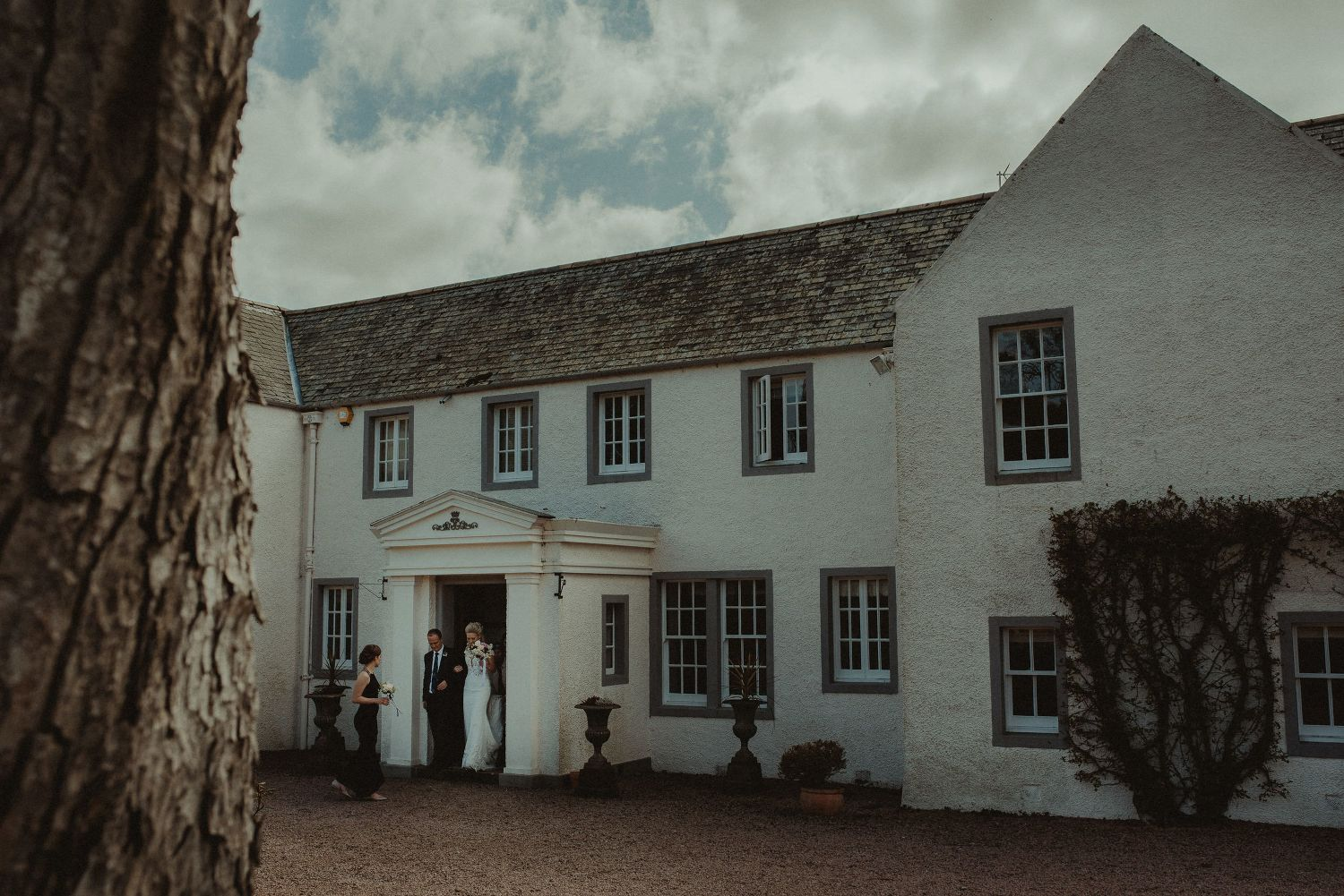 Bride and her father walking to the wedding marquee at Elsick House