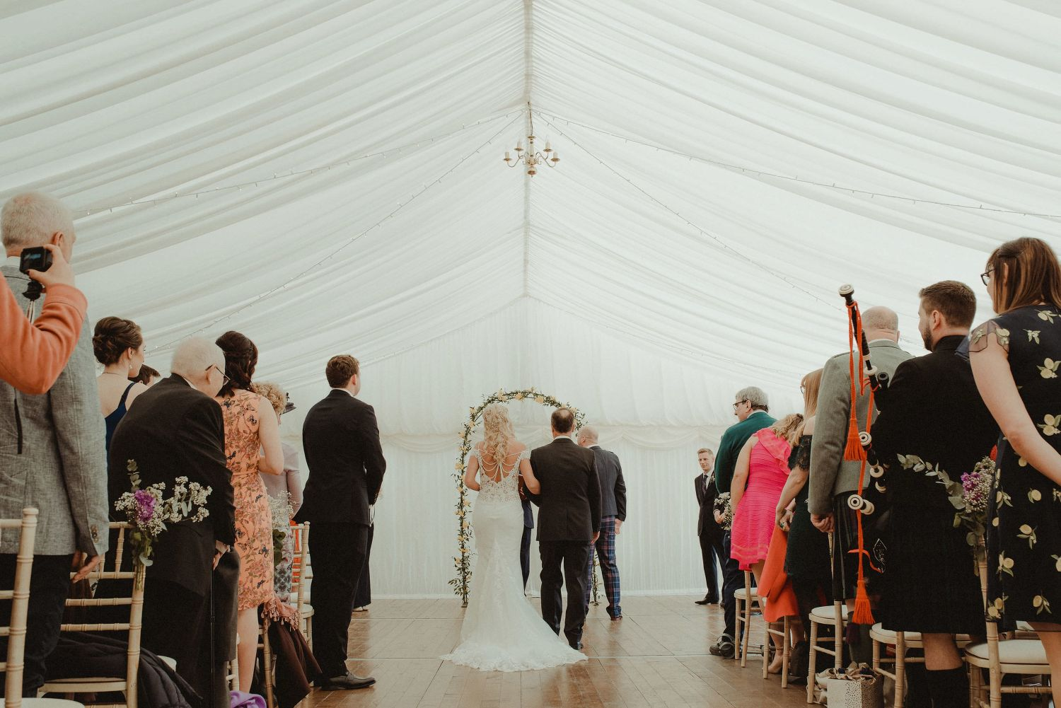 Bride walking down the aisle with her father at Elsick House