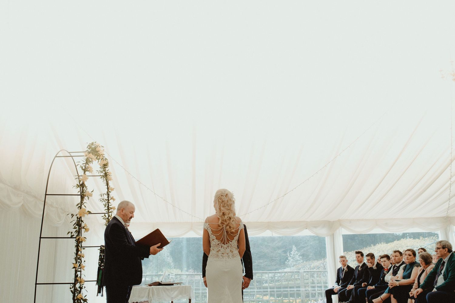 Bride and groom and the humanist at Elsick House
