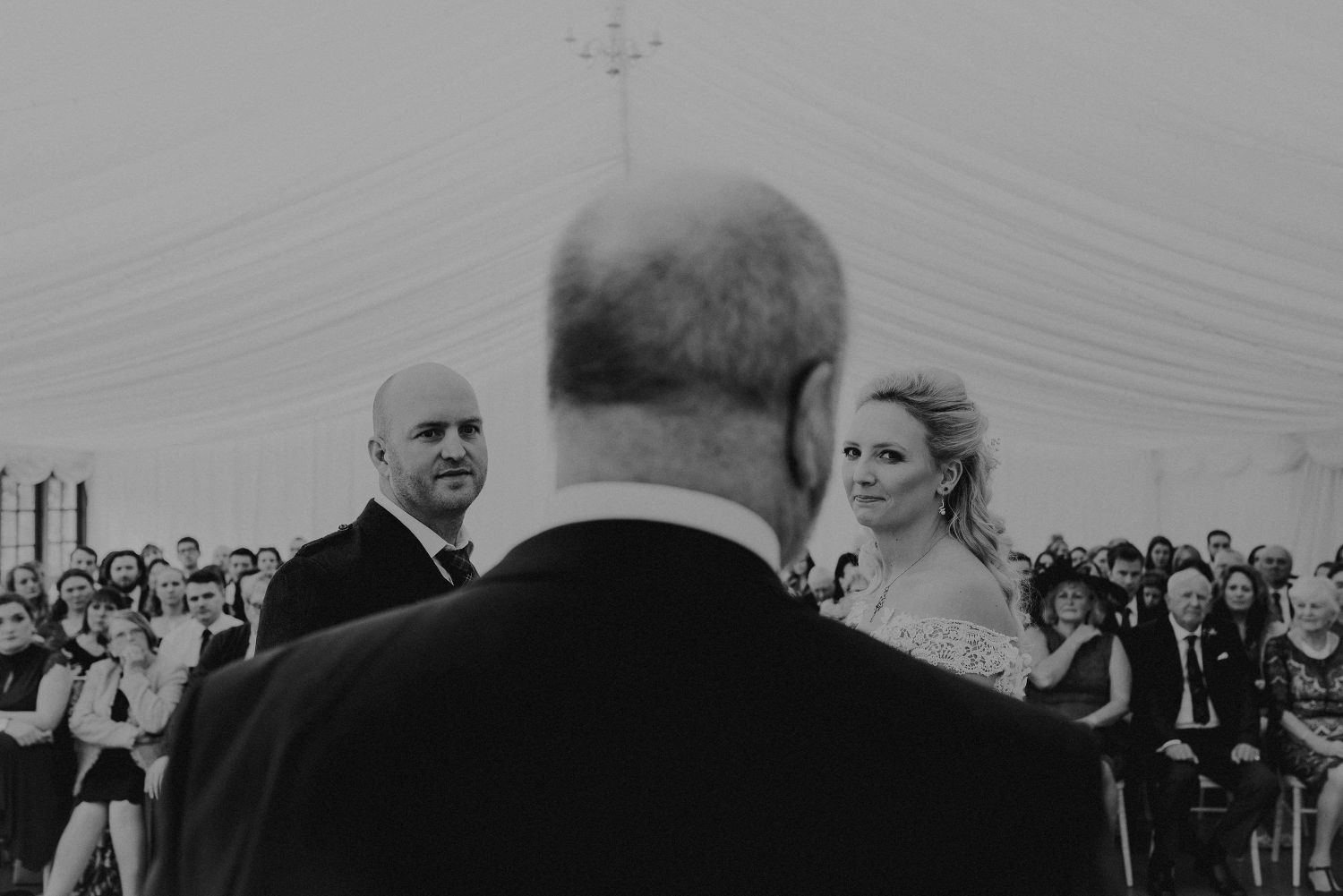 Bride, groom and the humanist at Elsick House Wedding