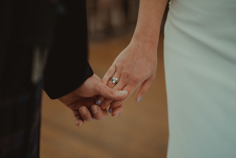 Groom holding bride's hand at Elsick House Wedding