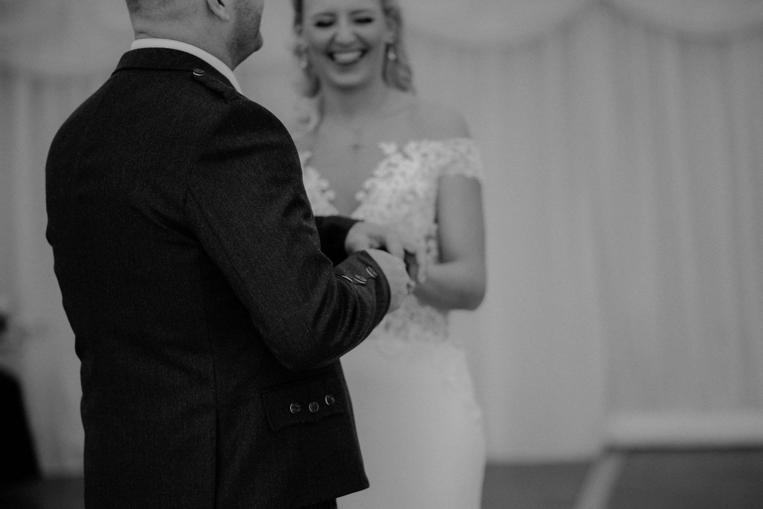 Bride and groom laughing at their wedding at Elsick House