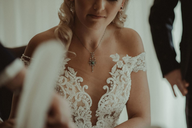 Bride signing the wedding register at Elsick House