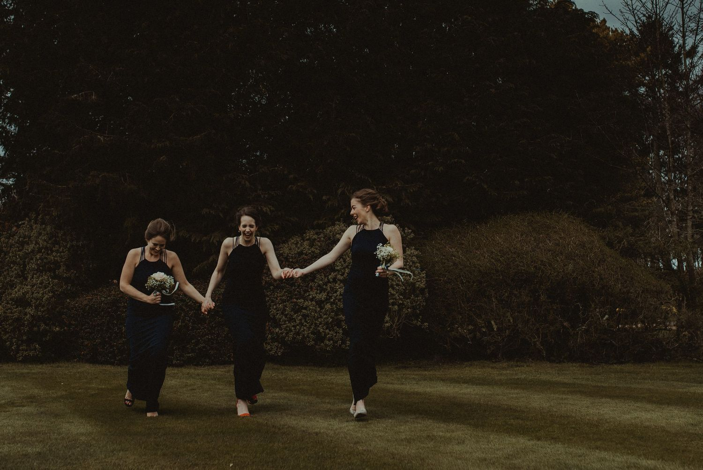 Running bridesmaids at Elsick House wedding